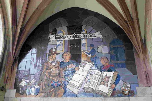 Dans l'escalier, Léo Shnug a aussi représenté l'atelier de calligraohie de Diebold Lauber, très célèbre au XV ème siècle.
